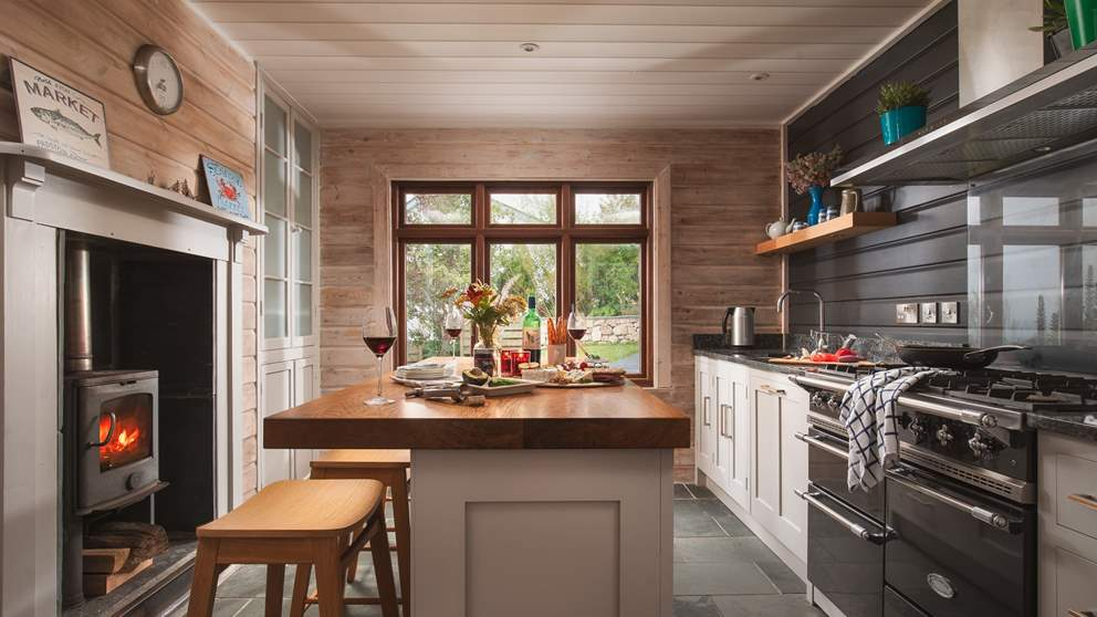 The incredible kitchen is fully equipped with everything you'll need - plus a wood burner!