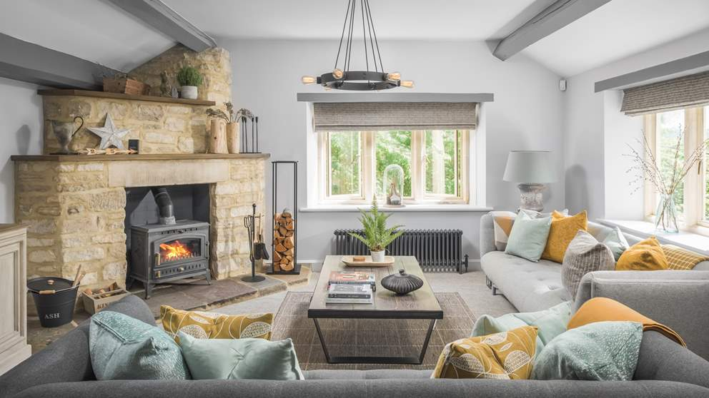 For cooler days, the spacious sitting room is a lovely place to gather around the huge wood burner