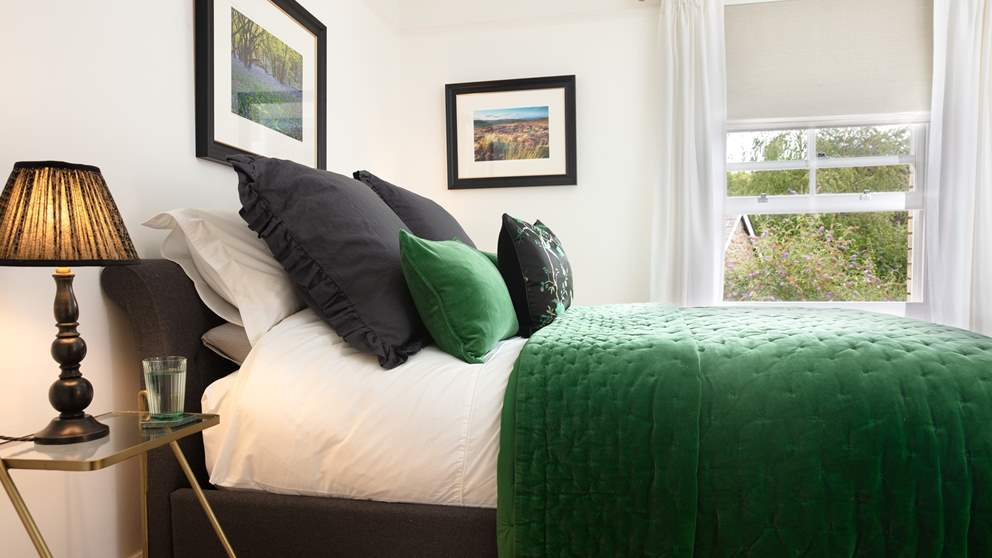 The master bedroom lies on the first floor and is pure elegance in shades of emerald and grey.