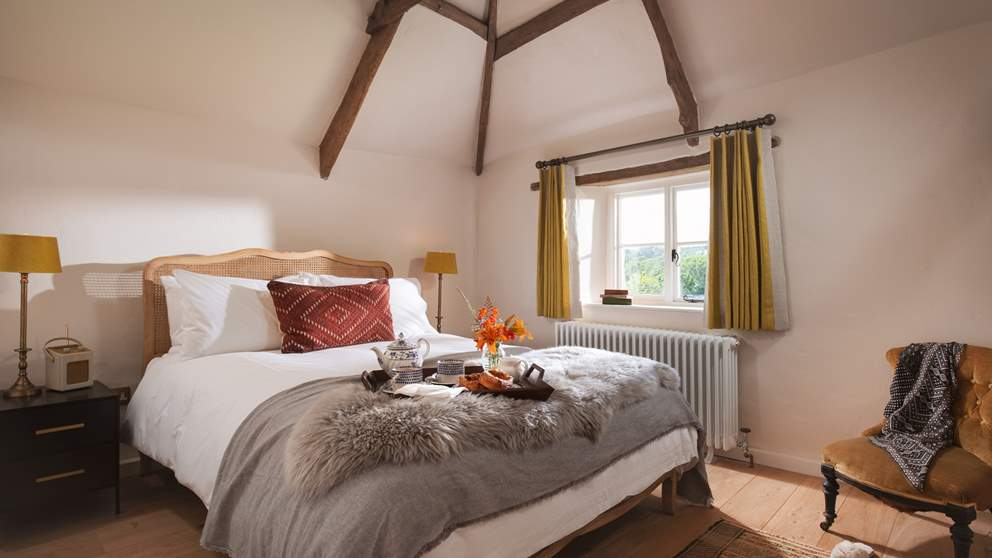 We love the vaulted ceiling and the French-inspired king size bed...so pretty