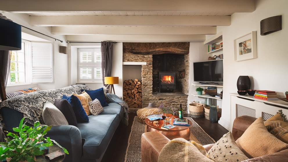 The supremely cosy sitting room just invites cosy nights in - and that woodburner!