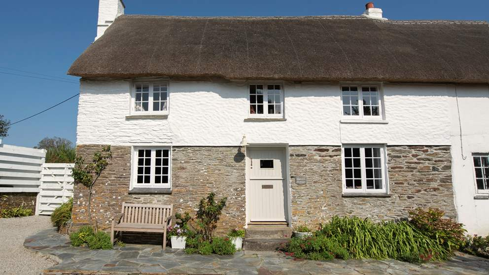 This wonderful Grade II listed Cornish semi-detached cottage offers a very warm welcome