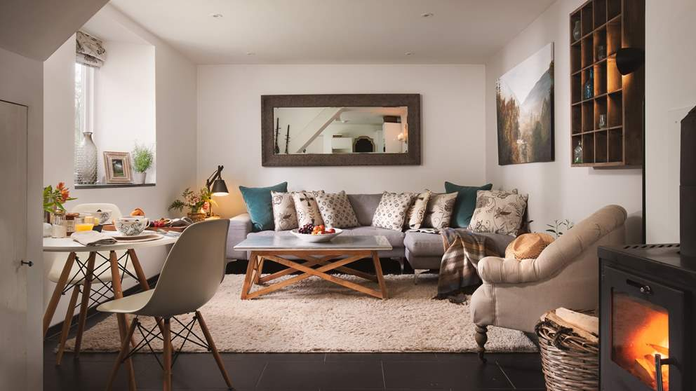 The downstairs living area is beautifully open plan to make the most of the cottage space.