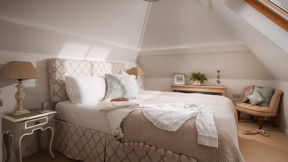 A gorgeously cosy king size bed, this is a blissful escape to retreat to at the end of a busy day exploring