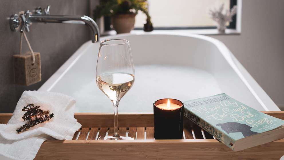 After a day's exploring out and about, nothing beats a long soak with a book and a glass of something special