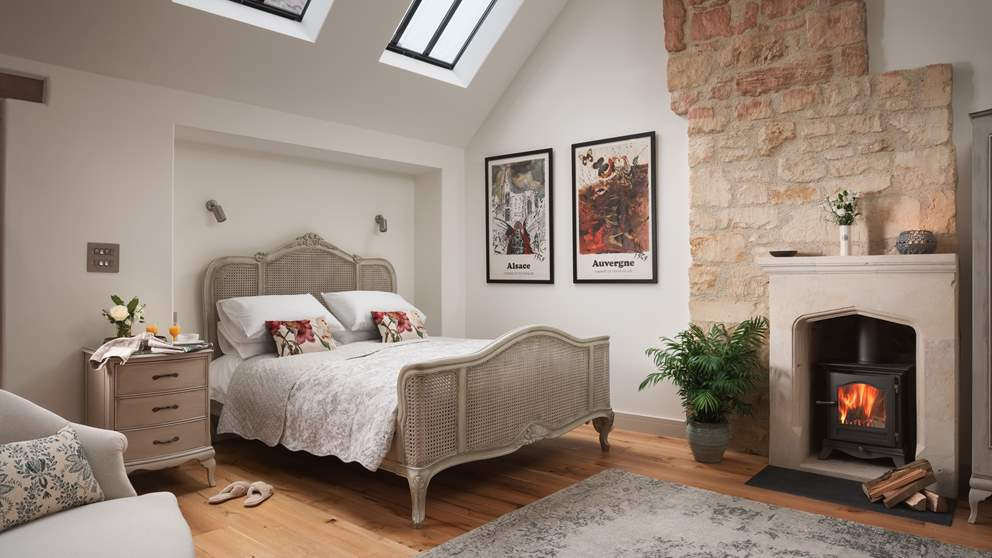 Oh-so-romantic, the exquisite bedroom can be found up the oak and glass stairs