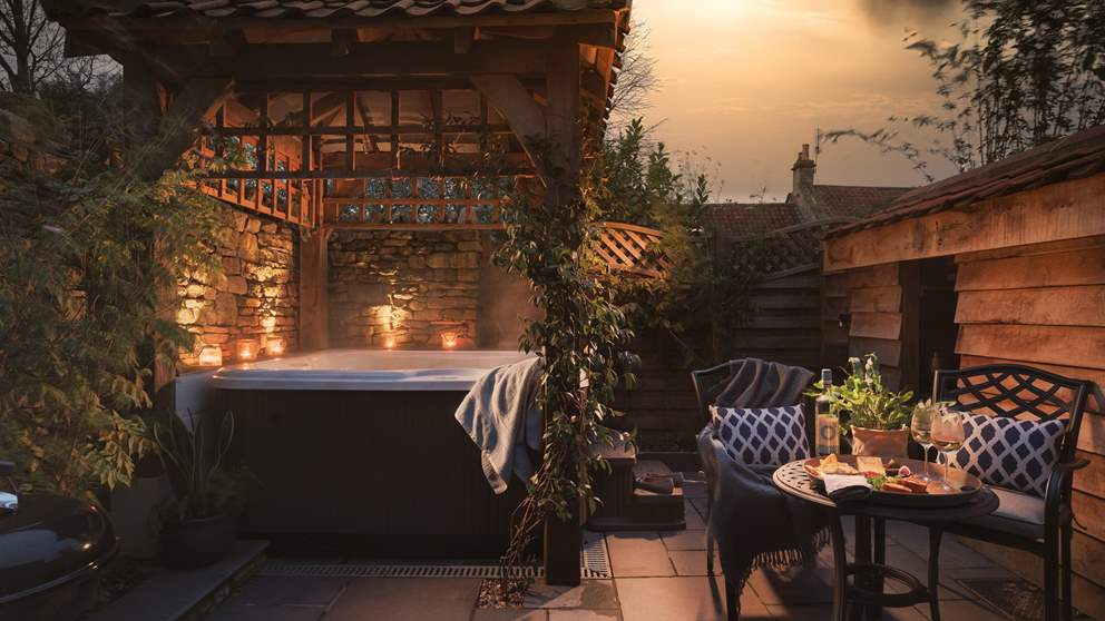 To the back of the garden lies the jacuzzi hot tub tucked under an oak gazebo