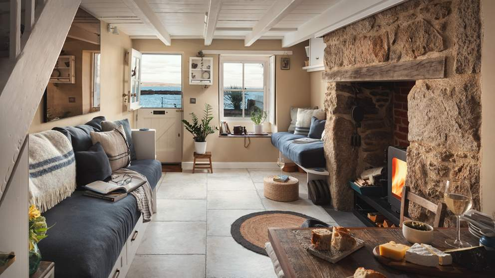 Immerse yourself in mesmerising sea views from the comfort of this cosy cottage, with a roaring wood burner and cheeseboard of course!