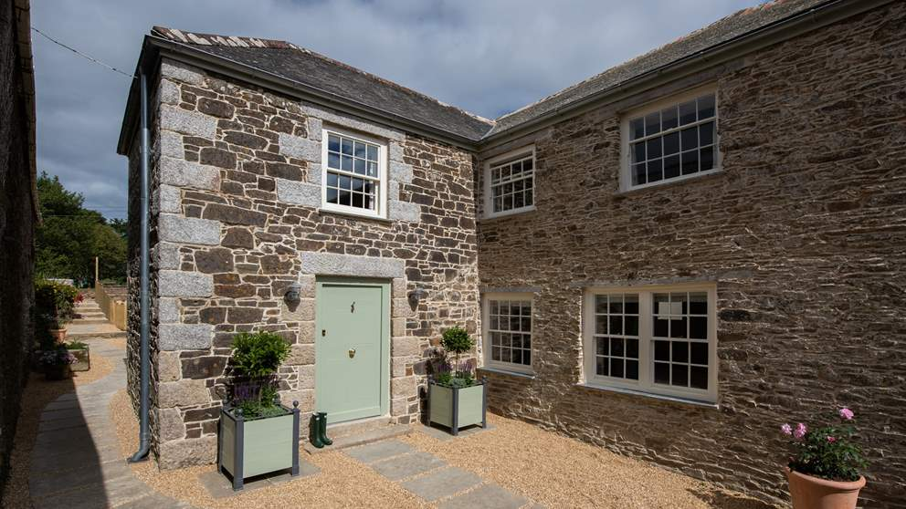 The pretty entrance and enclosed courtyard at Tremayne Farmhouse.