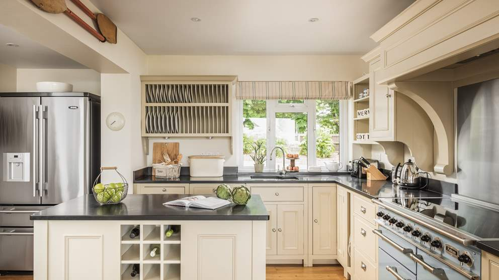 The open-plan kitchen has everything you'll need, from the Aga fridge to the Nespresso machine.