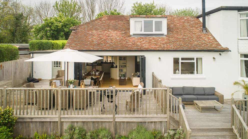 During warmer months, huge bi-fold doors open out to the large sun-soaked terrace bringing the outside in.