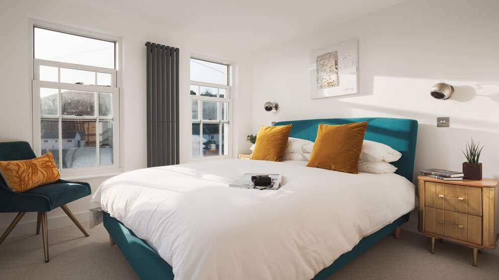 The master bedroom is a beautifully bright, light and tranquil room boasting three windows, all with sea views