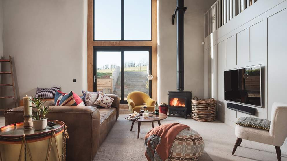 Just wow! The huge, double height sitting room is just breath-taking