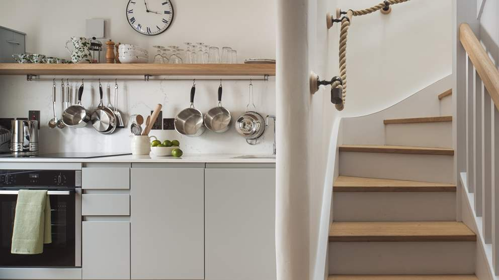 The sweetly simple galley kitchen is equipped with all the essentials