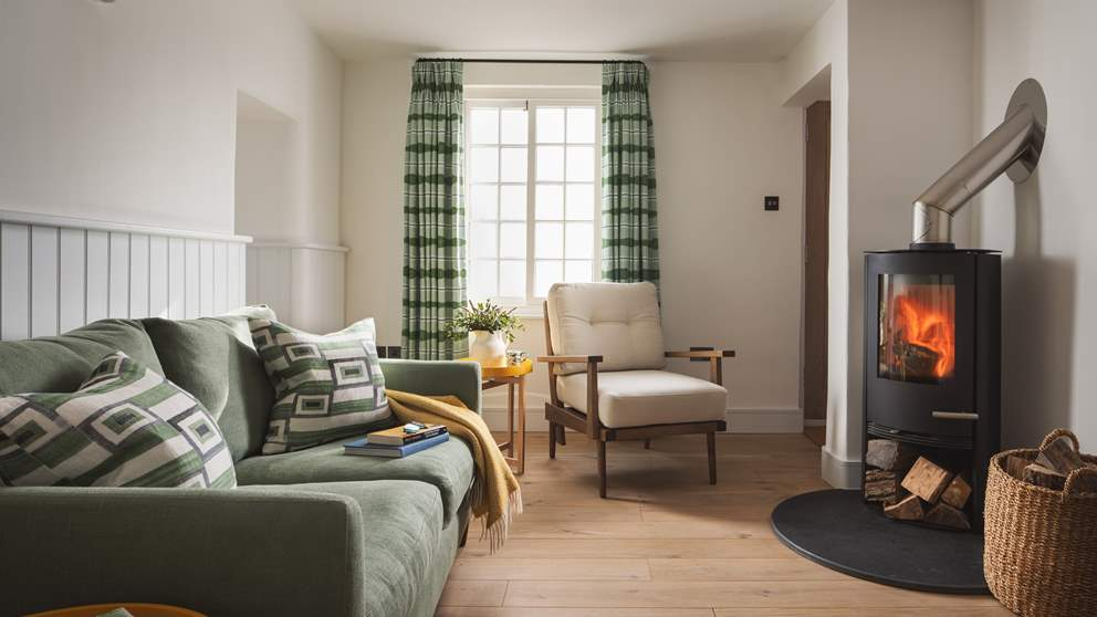 The cosy sitting room is just perfect to relax in at the end of a busy day exploring