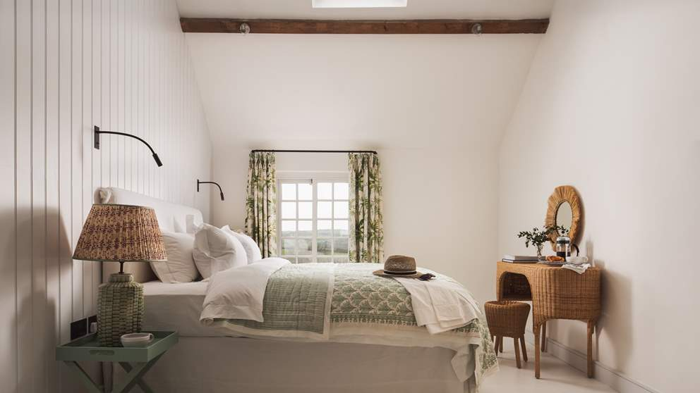 The master bedroom with en suite shower room has a wonderfully-comfy super king size bed
