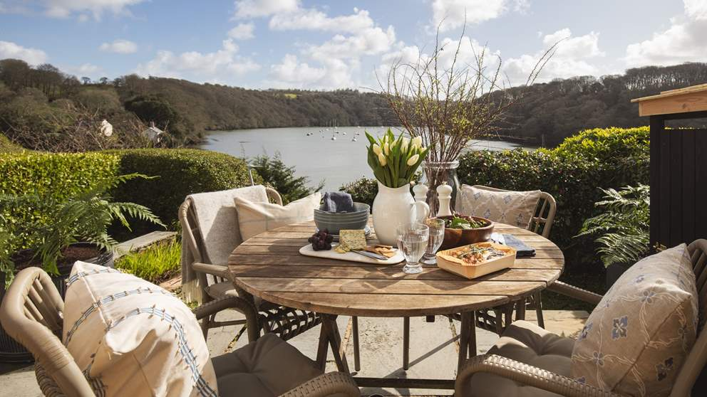 To the front of the property, overlooking the rivers, is a glorious sun-soaked terrace