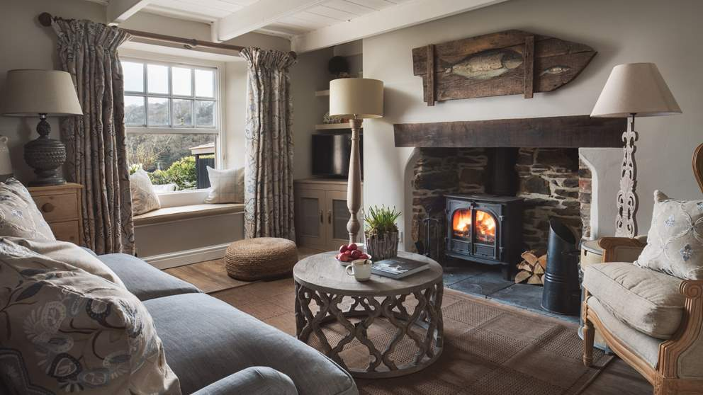 The charming sitting room retains all of its original character and is the perfect spot to retreat to when you need some downtime