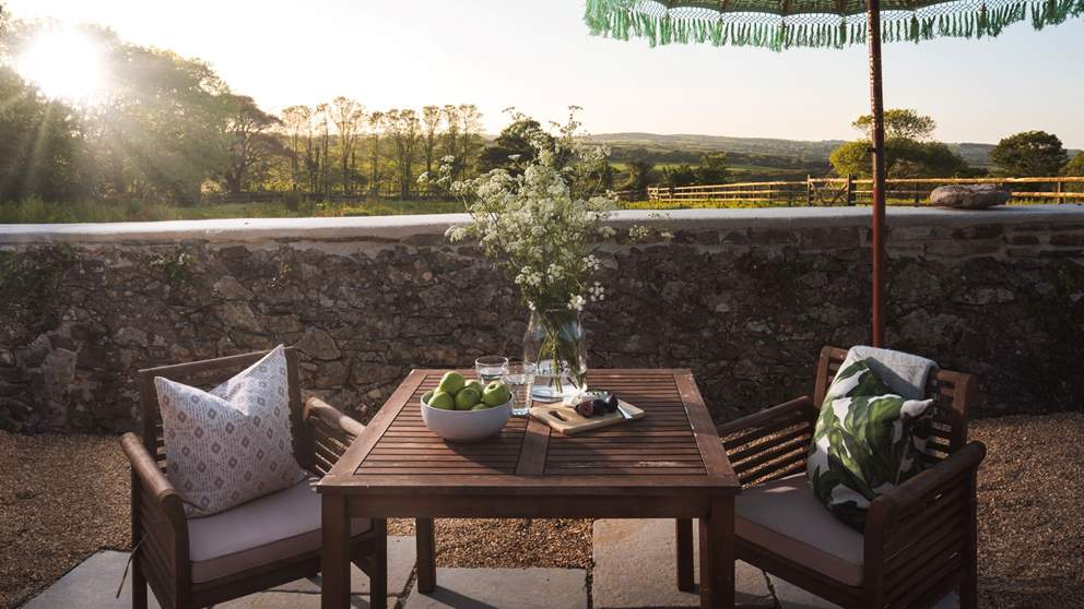 Take afternoon tea in the garden at the quaint table and chairs