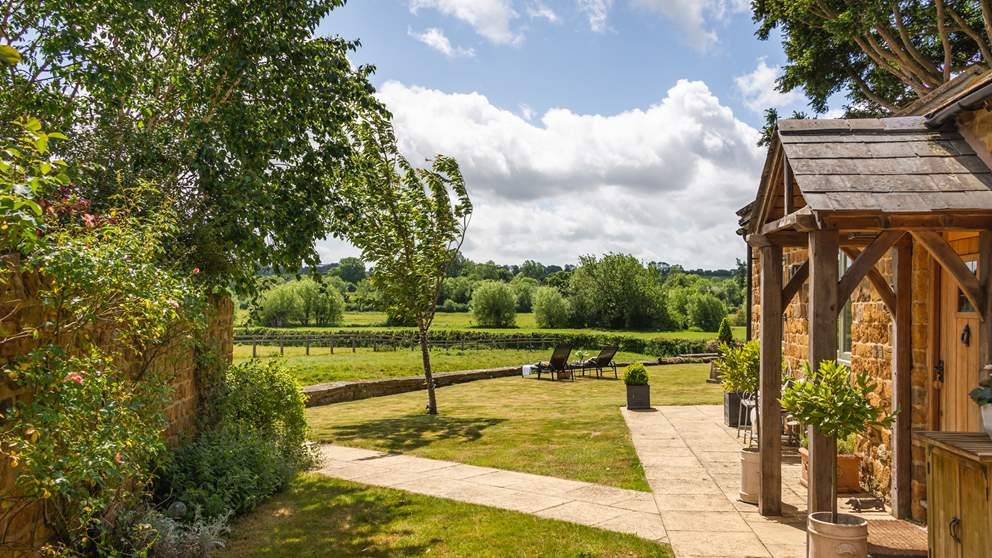 Outside, gorgeous gardens with a large lawn lead down to a ha-ha