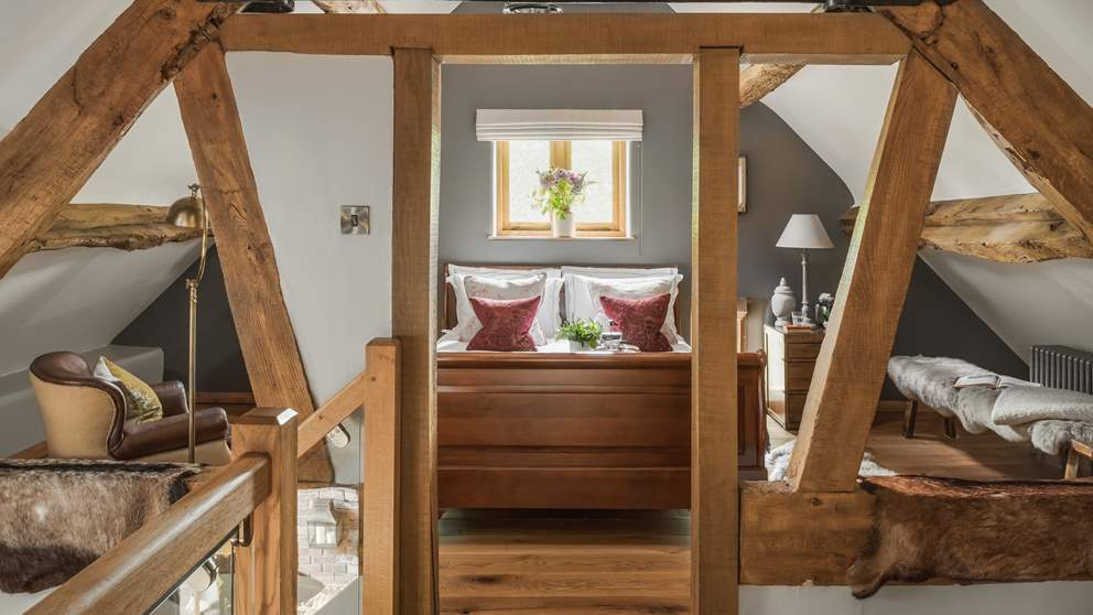 Set amongst the eaves with high vaulted ceiling and exposed beams, you'll be hard to find a more romantic spot