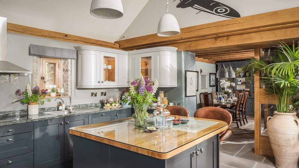 The exquisite kitchen, with gun-metal grey cupboards  marble worktops, has everything you'll need to create culinary masterpieces