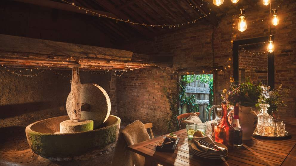 In warmer months dine in the adjacent cider barn, where you can sit next to the original apple press amongst the fairy lights.
