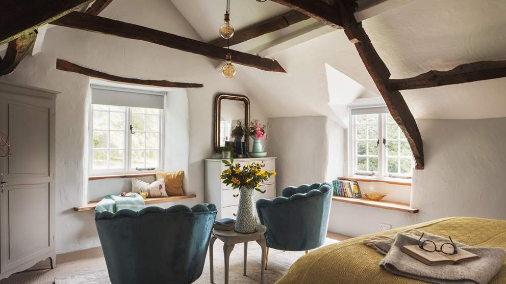 The pretty third bedroom has oodles of charm with picturesque vaulted ceiling, exposed wooden beams, dual aspect windows and original feature fireplace.