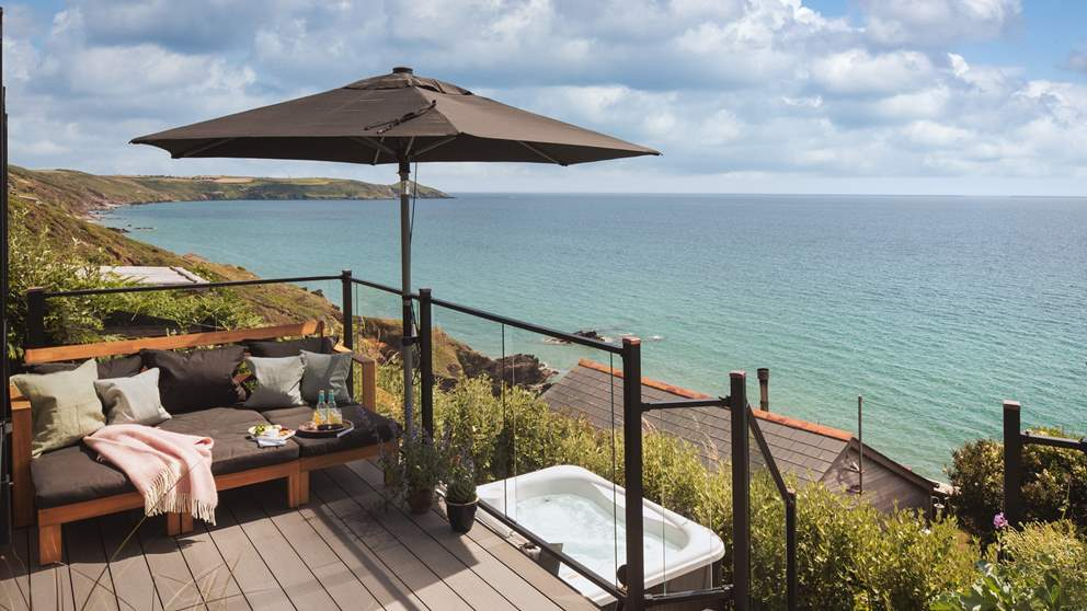 With gorgeous views over Whitsand Bay, there's a hot tub too
