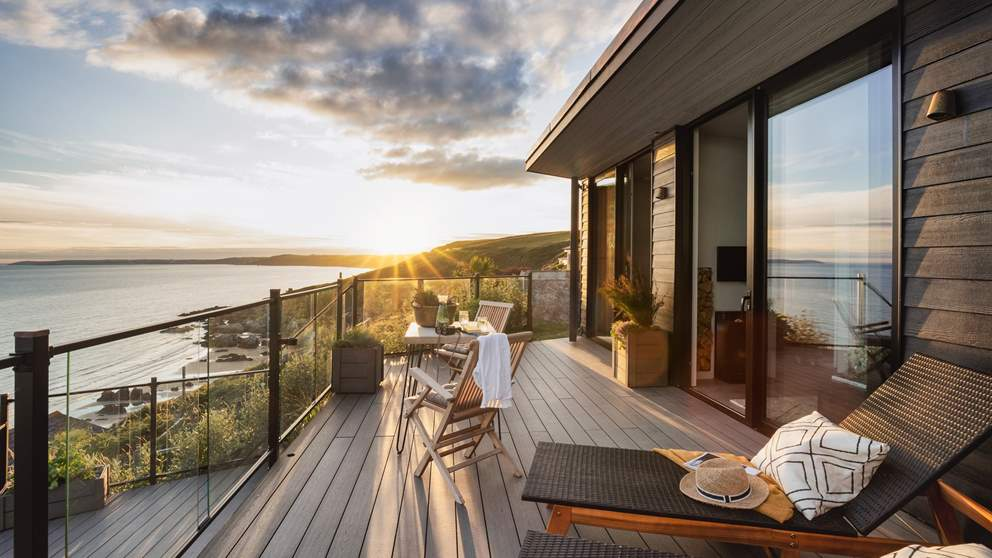With a blissful terrace overlooking the dreamy coastline, you'll not want to leave