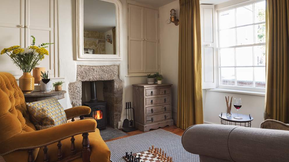 Cosy and charming, the petite sitting room is the perfect spot to return to at the end of the day