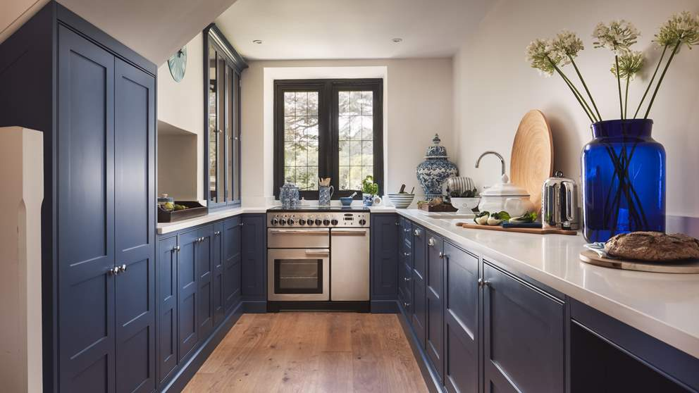 We have fallen in love with the spacious bespoke kitchen in Farrow & Ball Pitch Blue.