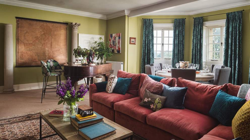 The stunning sitting room with huge bay windows overlooks the grounds and out to sea.