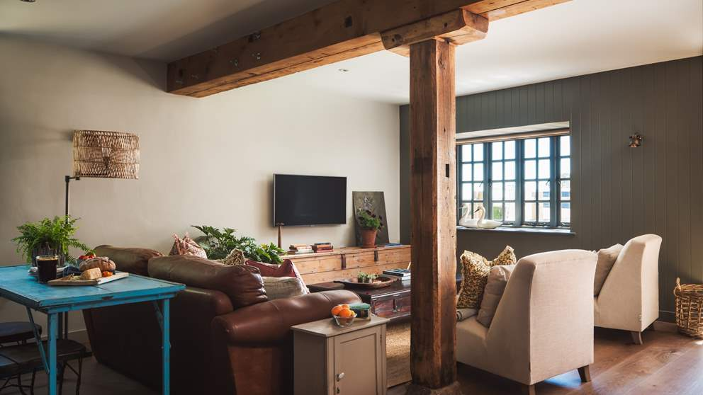 The sumptuous sitting room has a large leather sofa for cosying up on and two armchairs, so there's lots of space