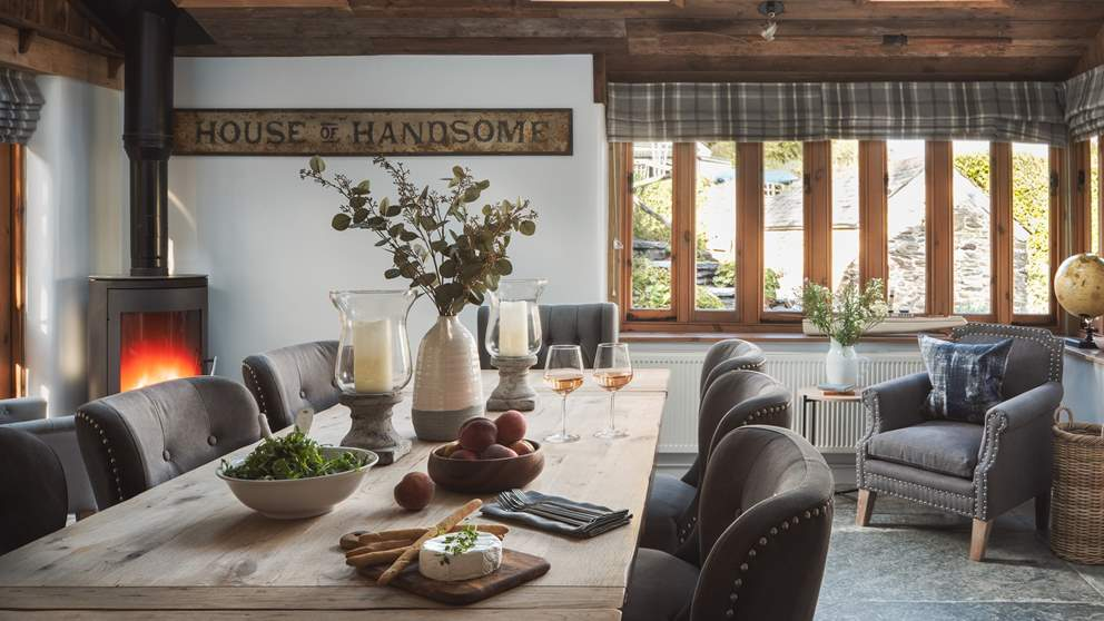 This is a lovely spot with the spacious country kitchen dining table for eight and the fabulous wood burning stove taking centre stage