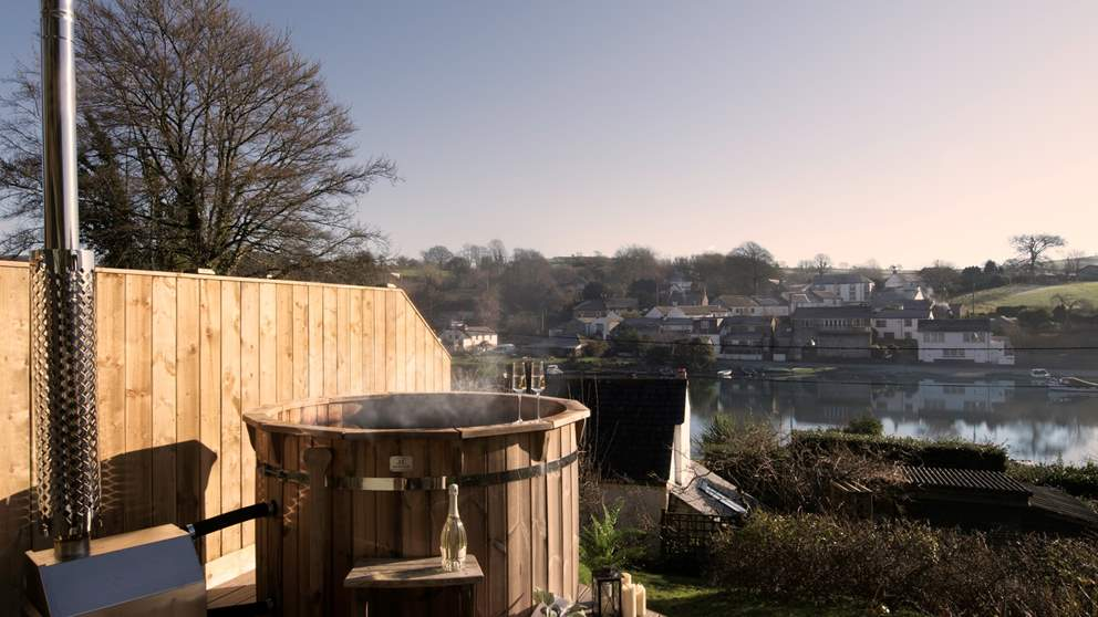 There's a wonderful wood-fired Cornish boat built hot tub on a raised deck for six, with spectacular river views