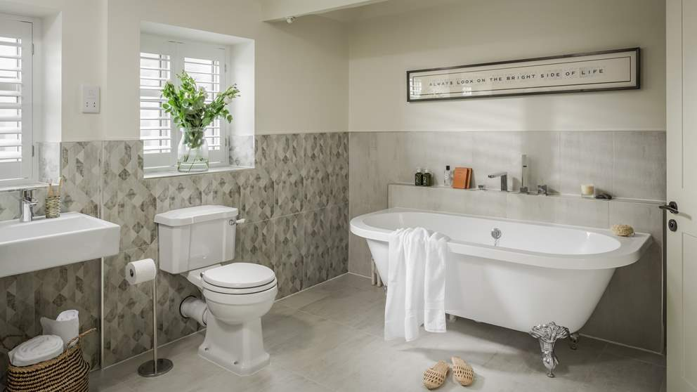 The family bathroom has a fabulous roll top bath for long soaks, plus a separate shower and double sink