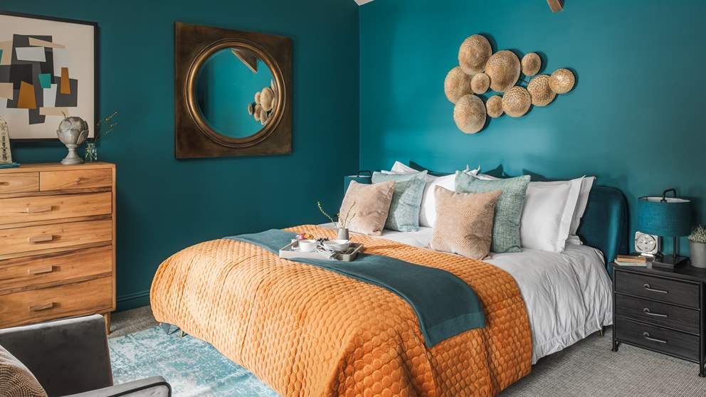 With a vaulted ceiling, teal walls and a sumptuous super king bed, this is a wonderful room to escape to  at the end of the day