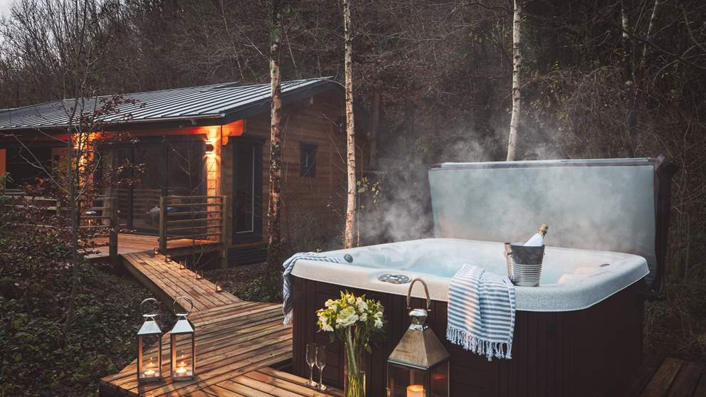 A bubbling hot tub makes this the go-to retreat for couples, friends, and families alike