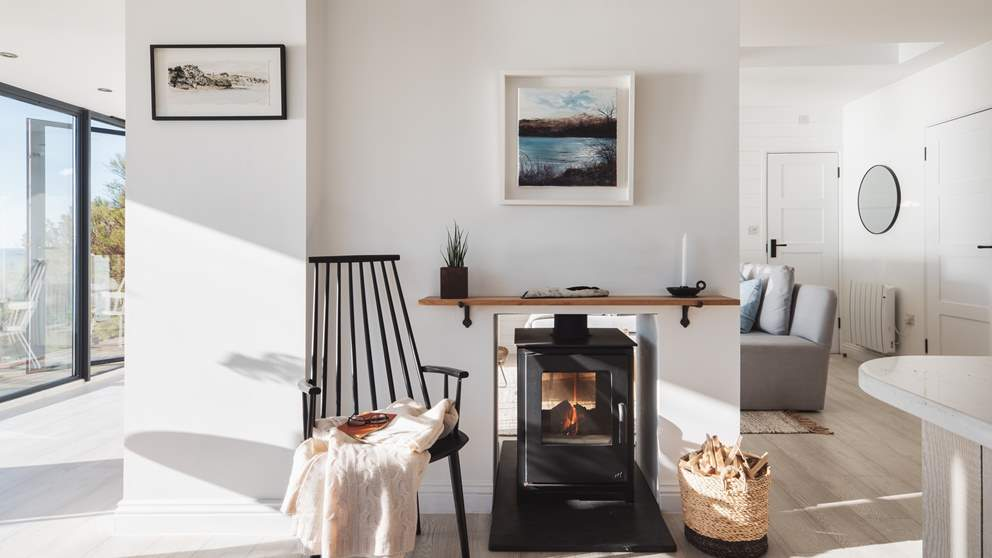 The cosy wood burner, accessible from both the sitting and dining areas, offer cosy heat during cooler months