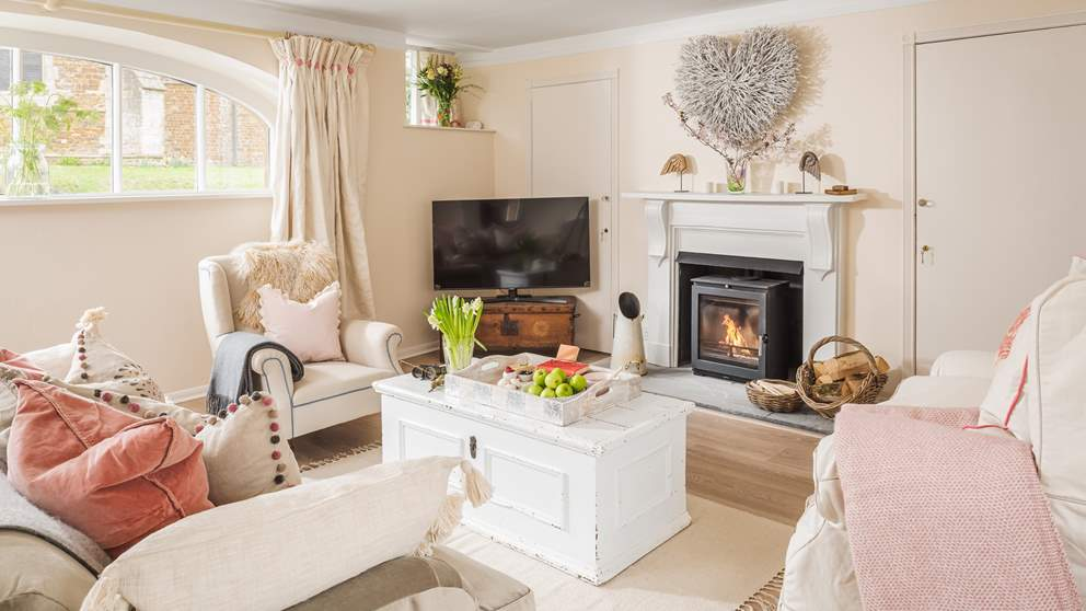 Oh-so-cosy, the sitting room with flickering wood burner is the perfect spot to unwind