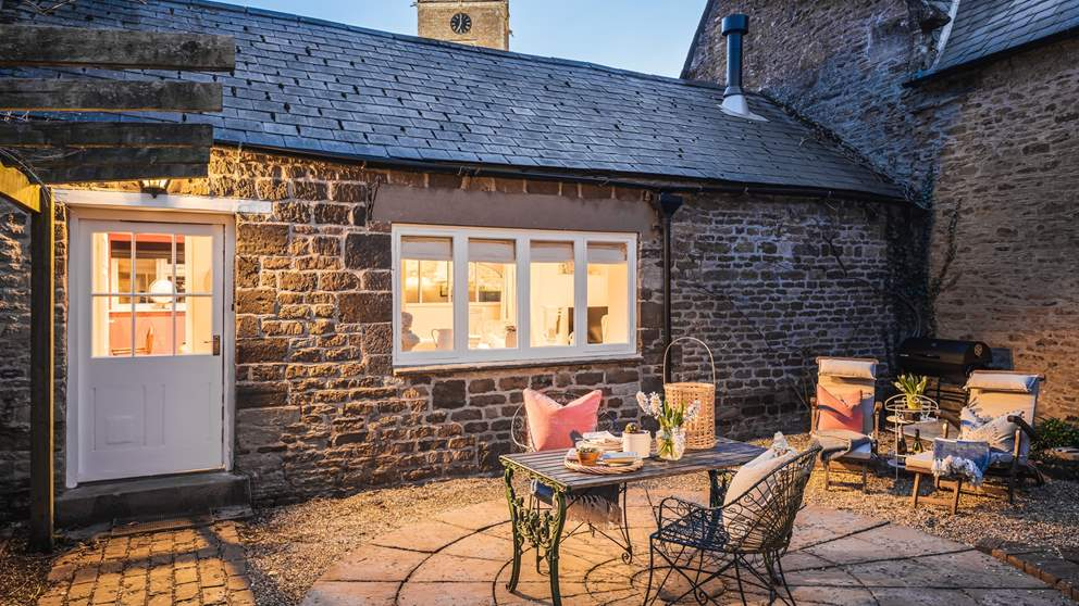 The enclosed courtyard is the perfect setting for meals alfresco, whether it's for breakfast or supper