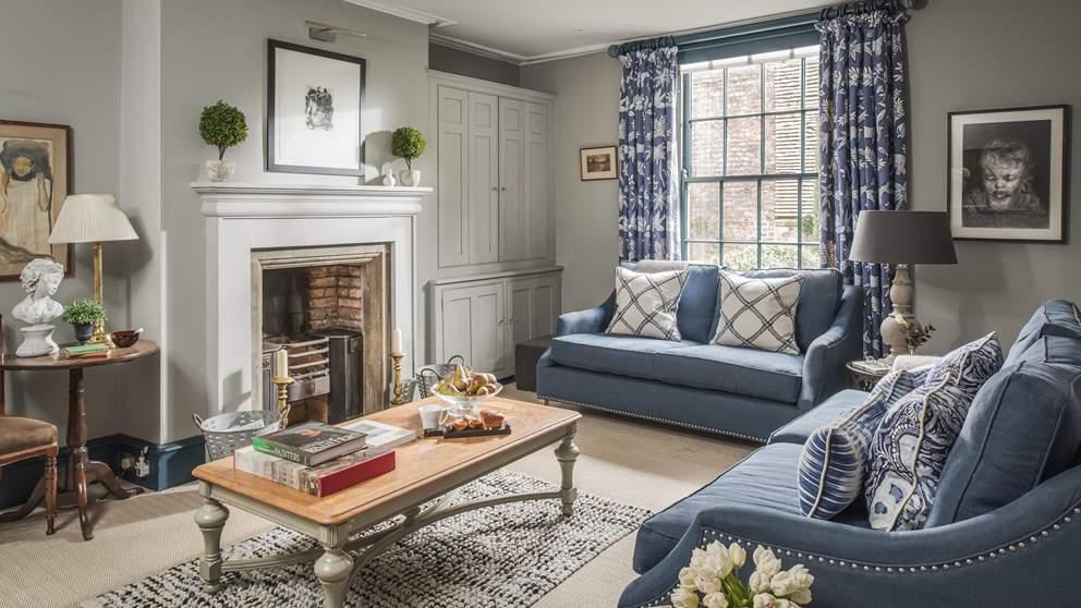The pretty sitting room, with double sofas, is the perfect place to escape to at the end of the day