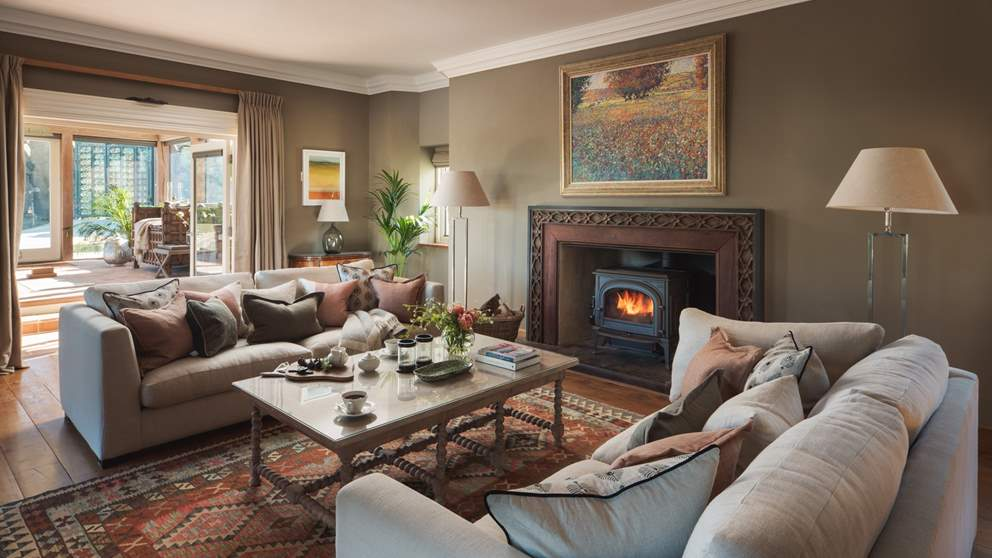 The sumptuous sitting room awaits for lazy evenings in front of the wood burner