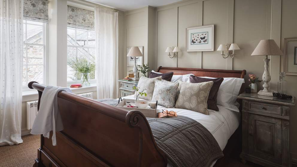 The stunning master bedroom with French bateau king-sized bed