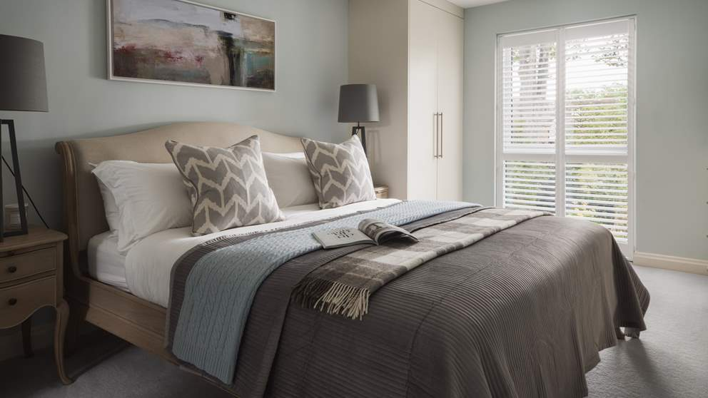 The gorgeously peaceful master bedroom