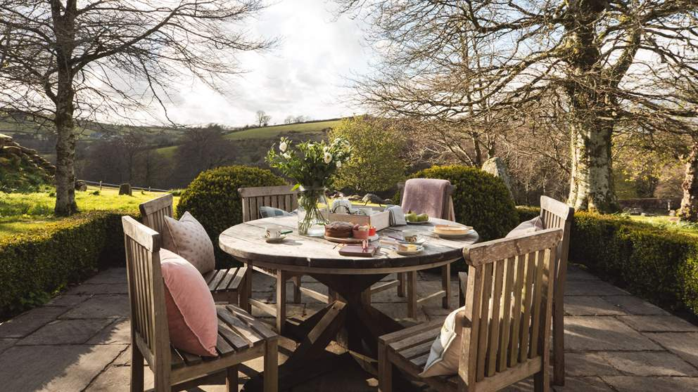 The sunny terrace is the perfect spot for meals, overlooking the stunning countryside