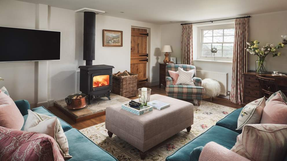 The oh-co-cosy sitting room awaits, resplendent with wood burner