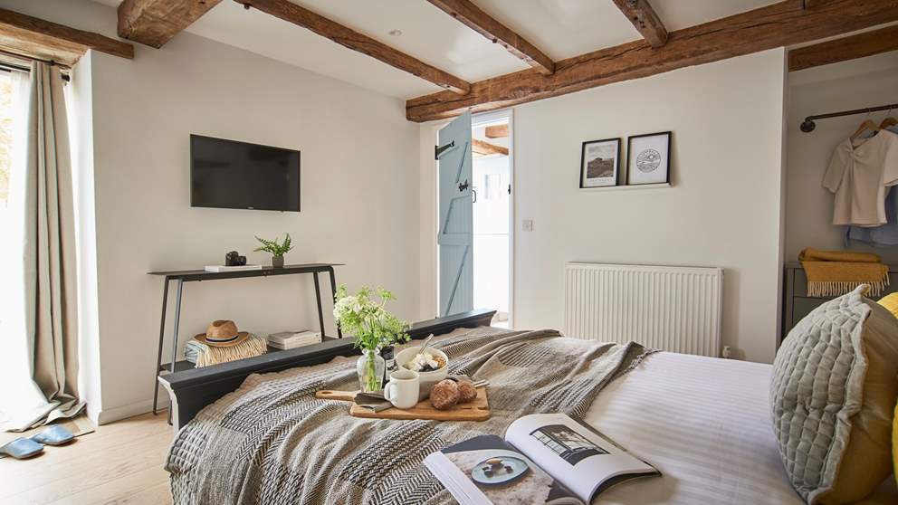 Set downstairs, the oh-so-romantic bedroom is a blissful retreat at the end of the day
