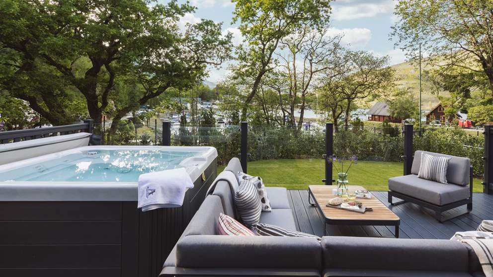 With a bubbling hot tub and plenty of space to relax, this is a lovely spot overlooking the marina